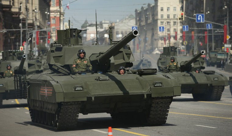 Russian Army T-14 Armata tanks drive towards Red Square to participate in the annual Victory Day Parade during celebrations marking the 70th anniversary of the victory over Nazi Germany and the end of World War II in Moscow. Celebrations are taking place throughout the day across the city. Most European leaders have snubbed the parade because they accuse Russia of actively interfering the war in eastern Ukraine. (Sean Gallup/Getty Images)