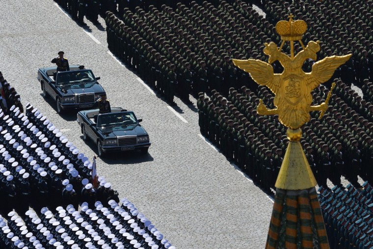 Russian soldiers stand at attention in Red Square during the Victory Day military parade in Moscow. Russian President Vladimir Putin presides over a huge Victory Day parade celebrating the 70th anniversary of the Soviet win over Nazi Germany, amid a Western boycott of the festivities over the Ukraine crisis. (Host Photo Agency/RIA via AFP/Getty Images)