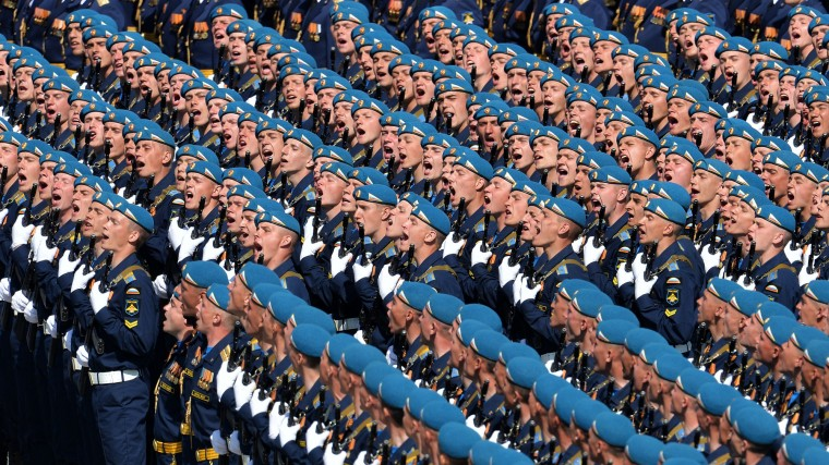 Russian soldiers march through Red Square during the Victory Day military parade in Moscow. Russian President Vladimir Putin presides over a huge Victory Day parade celebrating the 70th anniversary of the Soviet win over Nazi Germany, amid a Western boycott of the festivities over the Ukraine crisis. (Host Photo Agency/RIA via AFP/Getty Images)