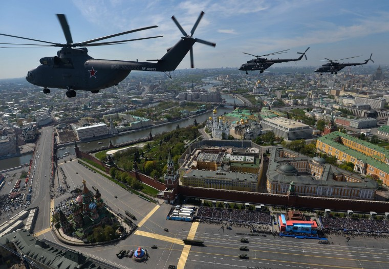 Russian Mil Mi-26 Halo helicopters fly over the Red Square in Moscow during the Victory Day military parade. Russian President Vladimir Putin presides over a huge Victory Day parade celebrating the 70th anniversary of the Soviet win over Nazi Germany, amid a Western boycott of the festivities over the Ukraine crisis. (Host Photo Agency/RIA via AFP/Getty Images)