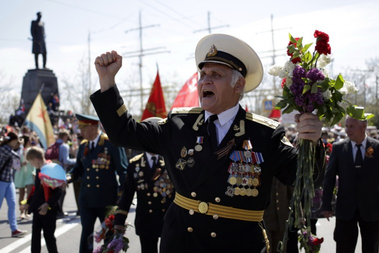 Crimean veterans march in central Sevastopol as they mark the 70th anniversary of the end of World War II. Russian President Vladimir Putin presided over a huge Victory Day parade celebrating the 70th anniversary of the Soviet win over Nazi Germany, amid a Western boycott of the festivities over the Ukraine crisis. (Max Vetrov/AFP-Getty Images)