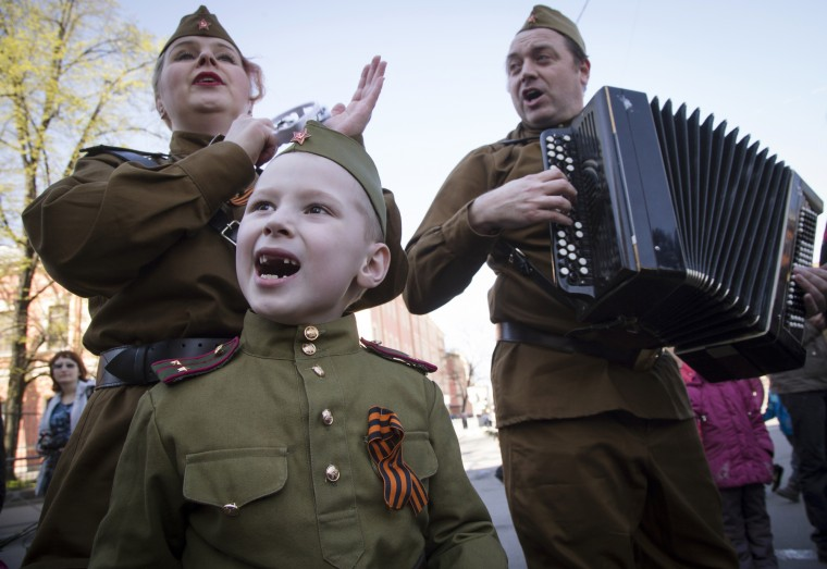Members of a historical military club wearing Soviet army uniforms sing during celebration of the 70th anniversary of the defeat of the Nazis in World War II in St. Petersburg, Russia. (Dmitry Lovetsky/Associated Press)