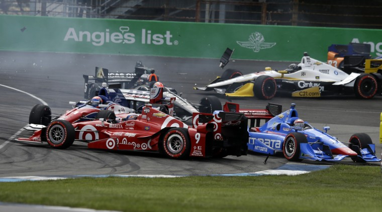 Scott Dixon (9) spins in front of the field on the start of the Grand Prix of Indianapolis auto race at Indianapolis Motor Speedway in Indianapolis. (Michael Conroy/Associated Press)
