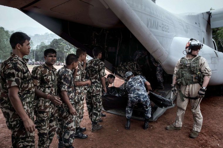 Nepalese soldiers unload relief supplies from an US Osprey aircraft at Dhading Besi, some 100 kms north west of Kathmandu. Following the 7.8 magnitude earthquake which struck the Himalayan nation on April 25, 2015, more than 131,500 Nepalese military and police personnel are taking part in the massive aid operation in the vast Himalayan nation, aided by more than 100 teams of foreign relief workers. (Philippe Lopez/AFP-Getty Images)