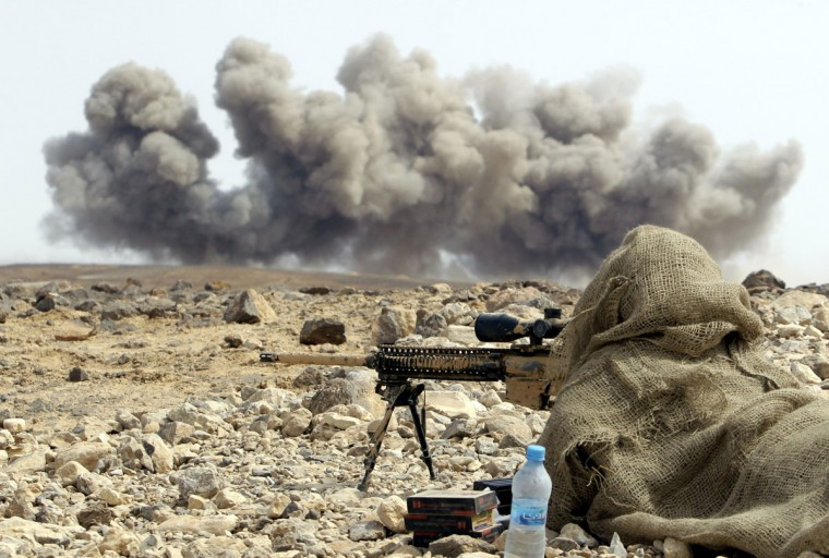 "A solider watches smoke rising as they take part in joint Jordan-US maneuvers during the ""Eager Lion"" military exercises, in Mudawwara, near the border with Saudi Arabia, on May 18, 2015. The annual ""Eager Lion"" exercises includes the participation of 10,000 troops from at least 18 countries, and incorporates scenarios including disaster relief and air defense. (KHALIL MAZRAAWI/AFP/Getty Images)"