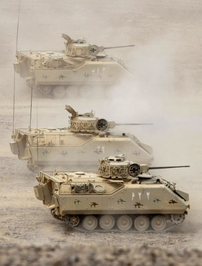 "Tanks advance as they take part in joint Jordan-US maneuvers during the Eager Lion military exercises in Mudawwara, near the border with Saudi Arabia, some 280 kilometres south of the Jordanian capital, Amman, on May 18, 2015. The annual ""Eager Lion"" exercises includes the participation of 10,000 troops from at least 18 countries, and incorporates scenarios including disaster relief and air defense. (KHALIL MAZRAAWI/AFP/Getty Images)"