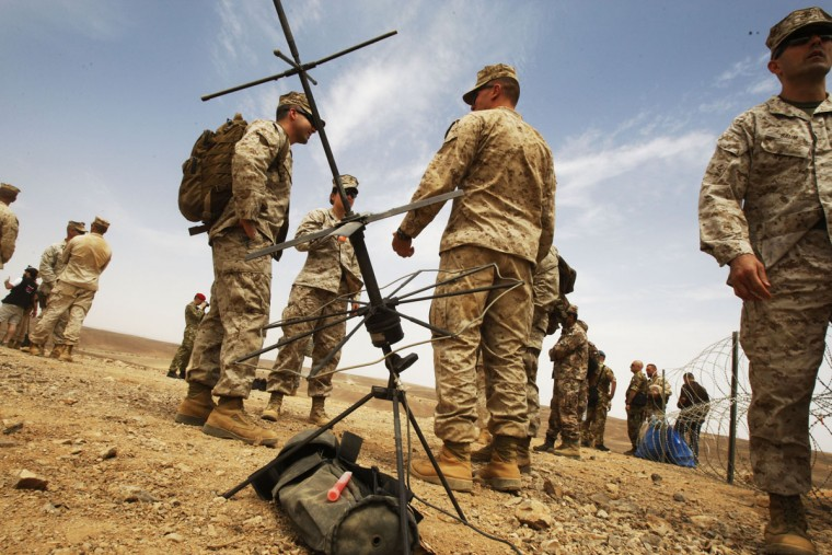 Jordanian and U.S. in addition to Italians participate in the final counter attack during the 5th annual exercise Eager Lion 2015, in the south-east desert of Wadi Shadiyah, Jordan on May 18, 2015. The final exercise included 2 U.S. B-52 Stratofortress Aircraft in a 35-hour mission from the U.S. to Jordan directly and back, Jordanian F-16 fighting falcons, high-mobility artillery rocket system (HIMARS), 4 Royal Jordanian air force AH-1 Cobras, 3 U.S. AH-64 Apaches, Tanks, Anti- Tank Guided Missiles, and Heavy Machine Guns. (Photo by Jordan Pix/ Getty Images)