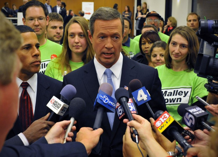 Maryland Governor Martin O'Malley, center, and Lt. Governor Anthony Brown, left, talk with reporters after facing off with gubernatorial candidate Robert Ehrlich in the last debate before their election, October, 14, 2010 in Washington, DC. (Photo by Bill O'Leary/The Washington Post)