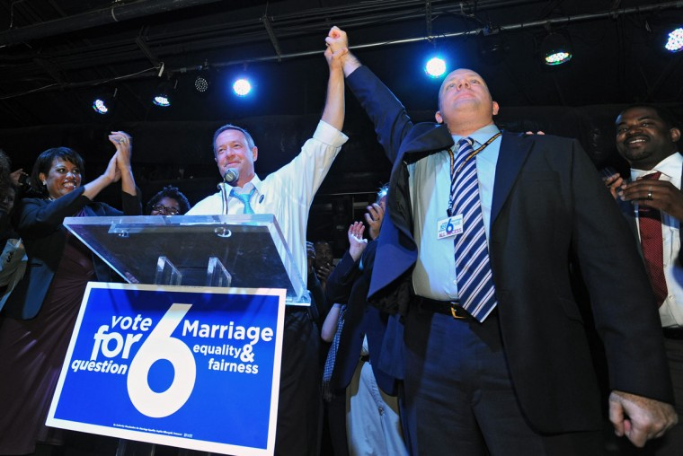 Maryland Gov. Martin O'Malley, center, celebrates with Josh Levin after the passage of Question 6 for same-sex marriage, at The Sound Stage on election night. Photo by: Kenneth K. Lam/The Baltimore Sun