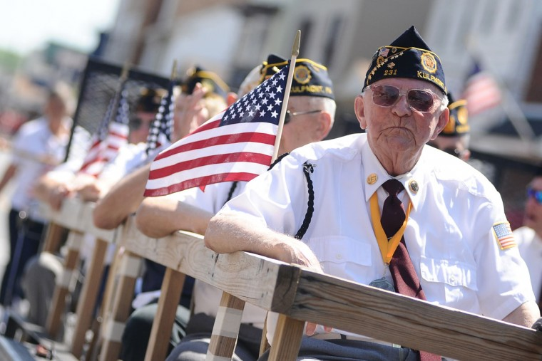 Veterans ride on a float during a Memorial Day parade Monday, May 25, 2015, in Kulpmont, Pa. A service followed the parade. (Larry Deklinski/The News-Item via AP)