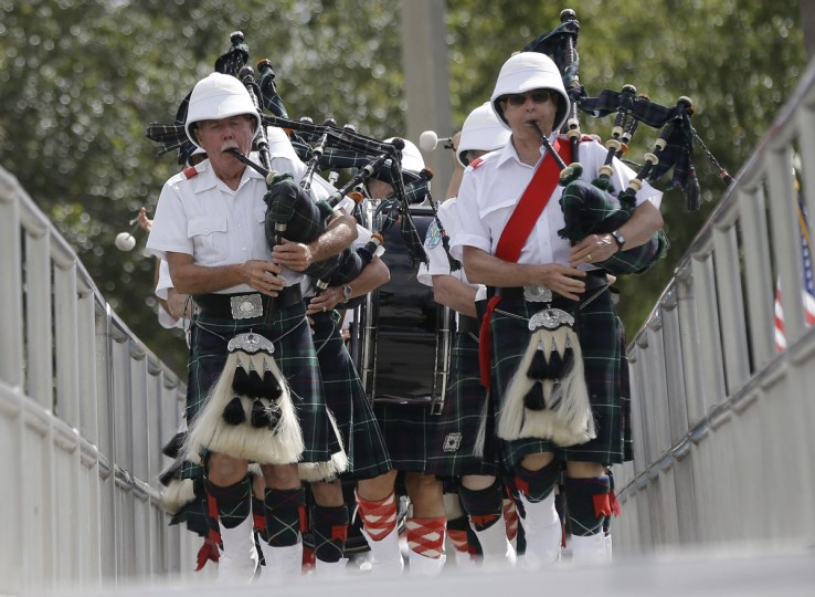 Robert Ritchie, left, and Nigel MacDonald, right, march with the St. Andrews Pipe Band of Miami during a Memorial Day event, Monday, May 25, 2015, in North Miami Beach, Fla. (AP Photo/Lynne Sladky)