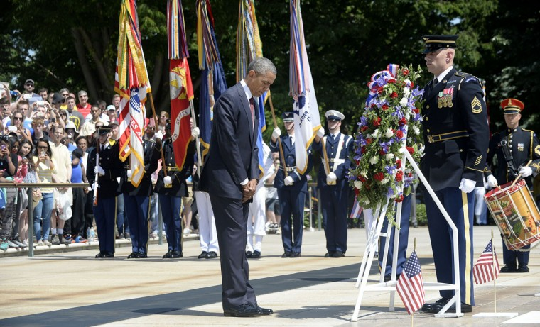 U.S. President Barack Obama lays a wreath at the Tomb of the Unknown Soldier at Arlington National Cemetery on Monday, May 25, 2015, in Arlington, Va. (Olivier Douliery/Abaca Press/TNS)