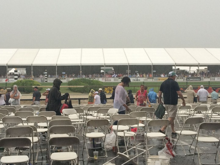 Throngs of die-hard fans brave the torrential downpour and line up at the track shortly before the running of the Preakness race. (Quinn Kelley/Baltimore Sun)