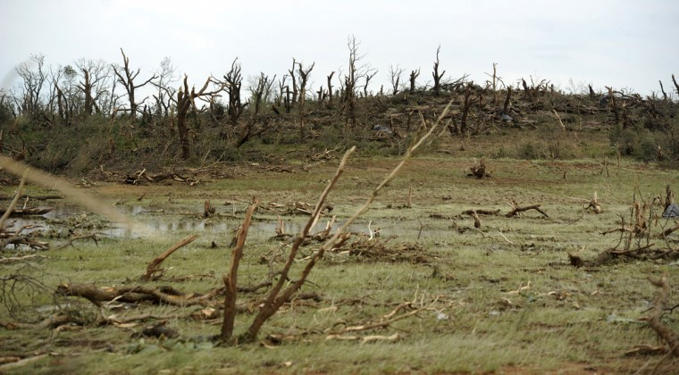 Debris lines a tornado's path of destruction after a deadly storm south of Cisco, Texas, Sunday, May 10, 2015. People in the sparsely populated ranching and farming community of Cisco were left to clean up from Saturday's tornado that left one person dead and another in critical condition. Cisco Fire Department spokesman Phillip Truitt said the two people were near each other. (Tommy Metthe/The Abilene Reporter-News via AP)