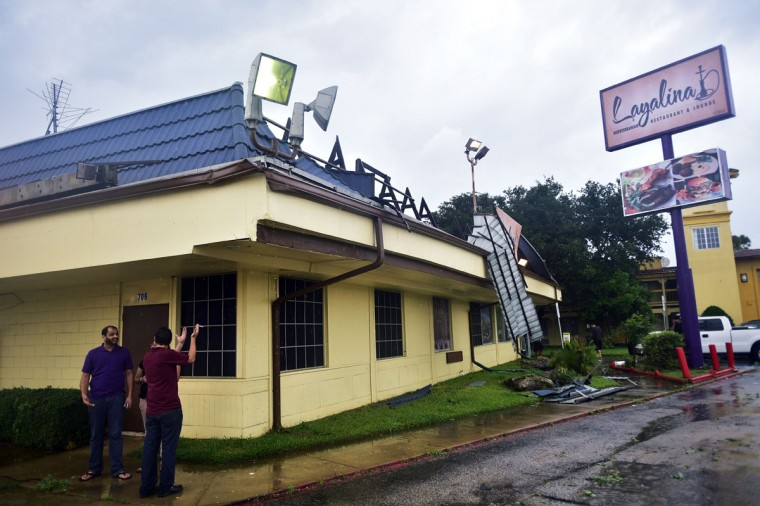 Layalina restaurant on Fort Worth Dr was damaged as a rain-wrapped tornado swept from Argyle north through Denton, Sunday, May 10, 2015, in Denton, Texas. (David Minton/The Dallas Morning News via AP)