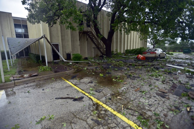 The Denton Baptist Temple was damaged as a rain-wrapped tornado swept from Argyle north through Denton,Texas, Sunday, May 10, 2015. (David Minton/The Dallas Morning News via AP)