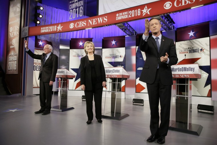 FILE - In this Saturday, Nov. 14, 2015 file photo, Democratic presidential candidates, from left, Bernie Sanders, Hillary Clinton and Martin O'Malley take the stage before a Democratic presidential primary debate in Des Moines, Iowa. (AP Photo/Charlie Neibergall)