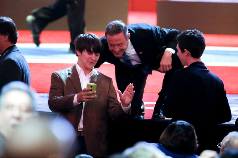 Democratic presidential candidate, former Maryland Gov. Martin O'Malley takes a selfie during a break at the NBC, YouTube Democratic presidential debate at the Gaillard Center, Sunday, Jan. 17, 2016, in Charleston, S.C. (AP Photo/Stephen B. Morton)