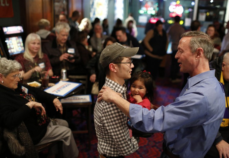 Henry Brownson, left, and his one-year-old Sophia introduces himself to Democratic presidential candidate, former Maryland Gov. MartinO'Malley, during a campaign stop Sunday, Jan. 31, 2016, in Waterloo, Iowa. (Matthew Putney/The Courier via AP)