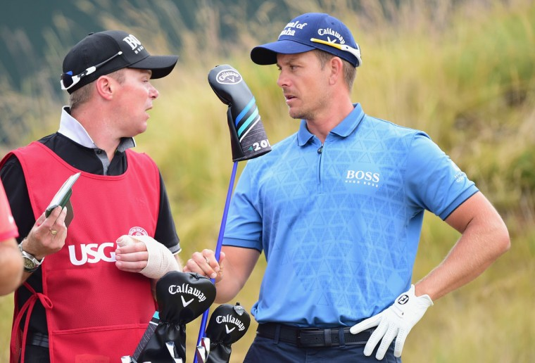 Henrik Stenson of Sweden waits with his caddie Gareth Lord on the sixth tee during the first round of the 115th U.S. Open Championship at Chambers Bay on June 18, 2015 in University Place, Washington. (Photo by Harry How/Getty Images)