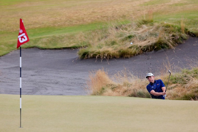 Cameron Smith of Australia plays a bunker shot on the 13th hole during the first round of the 115th U.S. Open Championship at Chambers Bay on June 18, 2015 in University Place, Washington. (Photo by David Cannon/Getty Images)