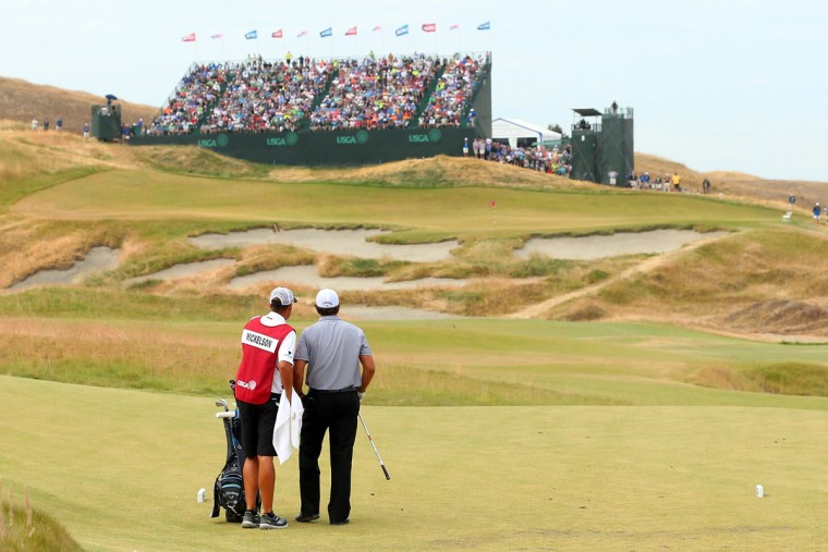 Phil Mickelson waits alongside his caddie Jim Mackay on the ninth fairway during the first round of the 115th U.S. Open Championship at Chambers Bay on June 18, 2015 in University Place, Washington. (Photo by Andrew Redington/Getty Images)