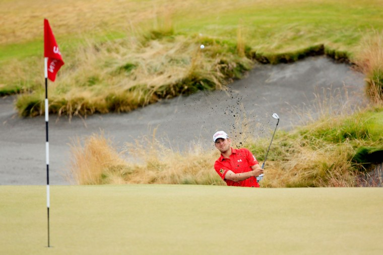 Bernd Wiesberger of Austria plays a bunker shot on the 13th hole during the first round of the 115th U.S. Open Championship at Chambers Bay on June 18, 2015 in University Place, Washington. (Photo by David Cannon/Getty Images)