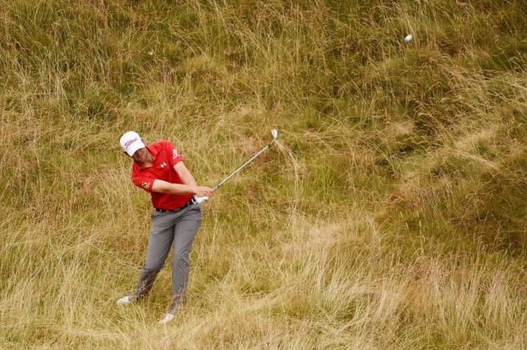 Bernd Wiesberger of Austria plays a shot from the rough on the 11th hole during the first round of the 115th U.S. Open Championship at Chambers Bay on June 18, 2015 in University Place, Washington. (Photo by Ross Kinnaird/Getty Images)