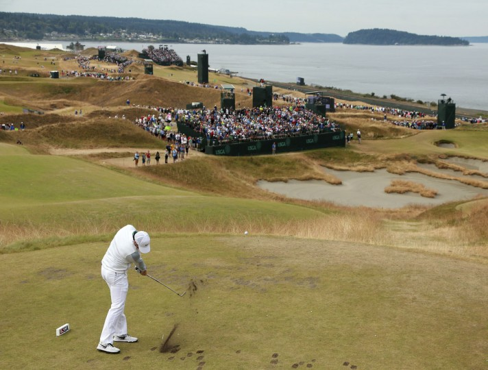 Rory McIlroy watches his tee shot on the 15th hole during the first round of the U.S. Open golf tournament at Chambers Bay on Thursday, June 18, 2015 in University Place, Wash. (AP Photo/Charlie Riedel)