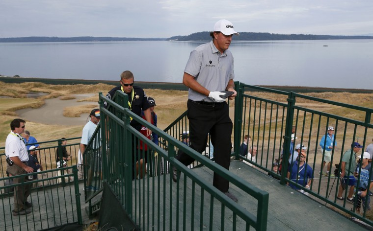 Phil Mickelson walks to the second hole during the first round of the U.S. Open golf tournament at Chambers Bay on Thursday, June 18, 2015 in University Place, Wash. (AP Photo/Matt York)