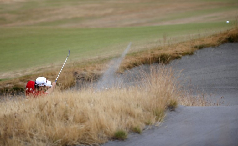 Bernd Wiesberger, of Austria, hits out of the bunker on the 11th hole during the first round of the U.S. Open golf tournament at Chambers Bay on Thursday, June 18, 2015 in University Place, Wash. (AP Photo/Lenny Ignelzi)