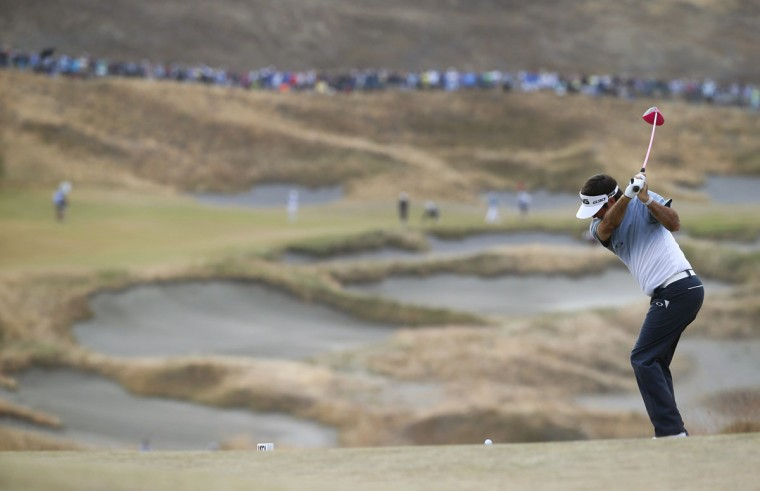Bubba Watson hits his tee shot on the fourth hole during the first round of the U.S. Open golf tournament at Chambers Bay on Thursday, June 18, 2015 in University Place, Wash. (AP Photo/Matt York)