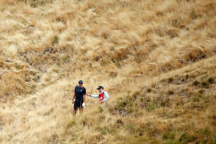 Dustin Johnson waits to play a shot from the rough on the tenth hole during the first round of the 115th U.S. Open Championship at Chambers Bay on June 18, 2015 in University Place, Washington. (Photo by Ezra Shaw/Getty Images)