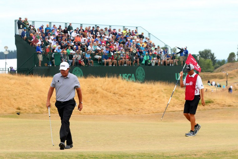Phil Mickelson walks off the sixth green during the first round of the 115th U.S. Open Championship at Chambers Bay on June 18, 2015 in University Place, Washington. (Photo by Andrew Redington/Getty Images)