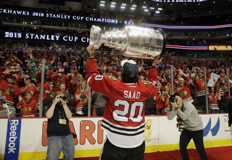 Chicago Blackhawksí Brandon Saad celebrates after defeating the Tampa Bay Lightning in Game 6 of the NHL hockey Stanley Cup Final series on Monday, June 15, 2015, in Chicago. The Blackhawks defeated the Lightning 2-0 to win the series 4-2. (AP Photo/Nam Y. Huh)