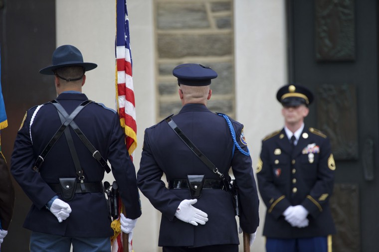 An honor guard stands at attention outside St. Anthony of Padua Church before a mass of Christian burial is held for former Delaware Attorney General Beau Biden in Wilmington, Delaware on June 6, 2015. U.S. President Barack Obama is expected to deliver a eulogy for the son of Vice President Joe Biden after he died at 46 following a two-year battle with brain cancer. (Photo by Mark Makela/Getty Images)