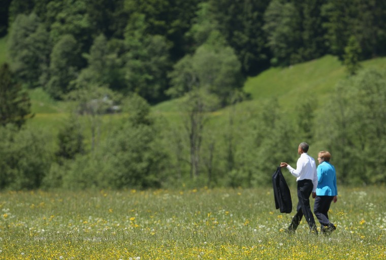 U.S. President Barack Obama and German Chancellor Angela Merkel stroll outside at the summit of G7 nations at Schloss Elmau on June 7, 2015 near Garmisch-Partenkirchen, Germany. In the course of the two-day summit G7 leaders are scheduled to discuss global economic and security issues, as well as pressing global health-related issues, including antibiotics-resistant bacteria and Ebola. Several thousand protesters have announced they will seek to march towards Schloss Elmau and at least 17,000 police are on hand to provide security. (Photo by Sean Gallup/Getty Images)