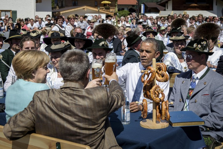 U.S. President Barack Obama shares a Bavarian breakfast with German Chancellor Angela Merkel and her husband Joachim Sauer prior the summit of G7 nations on June 7, 2015 in Kruen, Germany. In the course of the two-day summit G7 leaders are scheduled to discuss global economic and security issues, as well as pressing global health-related issues, including antibiotics-resistant bacteria and Ebola. Several thousand protesters have announced they will seek to march towards Schloss Elmau and at least 17,000 police are on hand to provide security. (Photo by Steffen Kugler - Pool/Getty Images)