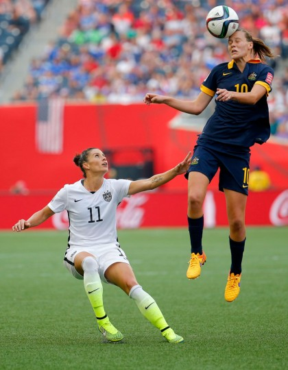 Emily Van Egmond #10 of Australia heads the ball against Alex Krieger #11 of United States in the second half during the FIFA Women's World Cup 2015 Group D match at Winnipeg Stadium on June 8, 2015 in Winnipeg, Canada. (Kevin C. Cox/Getty Images)