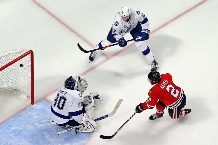 Duncan Keith #2 of the Chicago Blackhawks scores a goal in the second period against Ben Bishop #30 of the Tampa Bay Lightning during Game Six of the 2015 NHL Stanley Cup Final at the United Center on June 15, 2015 in Chicago, Illinois. (Photo by Bruce Bennett/Getty Images)