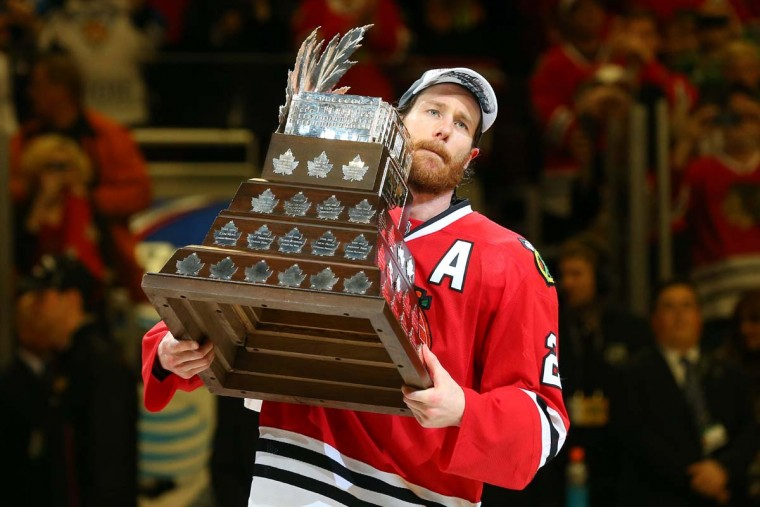 Duncan Keith #2 of the Chicago Blackhawks celebrates with the Conn Smythe trophy after defeating the Tampa Bay Lightning by a score of 2-0 in Game Six to win the 2015 NHL Stanley Cup Final at the United Center on June 15, 2015 in Chicago, Illinois. (Photo by Bruce Bennett/Getty Images)