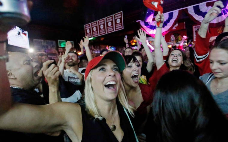 Jenna Didier (L) and Kara Christopher (C) of Chicago celebrate a goal during Game Six of the NHL 2015 Stanley Cup Final at Sluggers World Class Sports Bar on June 15, 2015 in Chicago, Illinois. (Photo by Jon Durr/Getty Images)