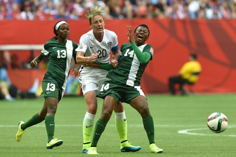 Abby Wambach #20 of the United States runs into Evelyn Nwabuoku #14 of Nigeria in the first half in the Group D match of the FIFA Women's World Cup Canada 2015 at BC Place Stadium on June 16, 2015 in Vancouver, Canada. (Rich Lam/Getty Images)