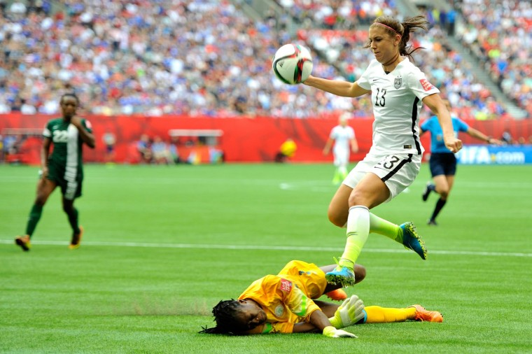 Goalkeeper Precious Dede #1 of Nigeria blocks the pass by Alex Morgan #13 of the United States in the first half in the Group D match of the FIFA Women's World Cup Canada 2015 at BC Place Stadium on June 16, 2015 in Vancouver, Canada. (Rich Lam/Getty Images)