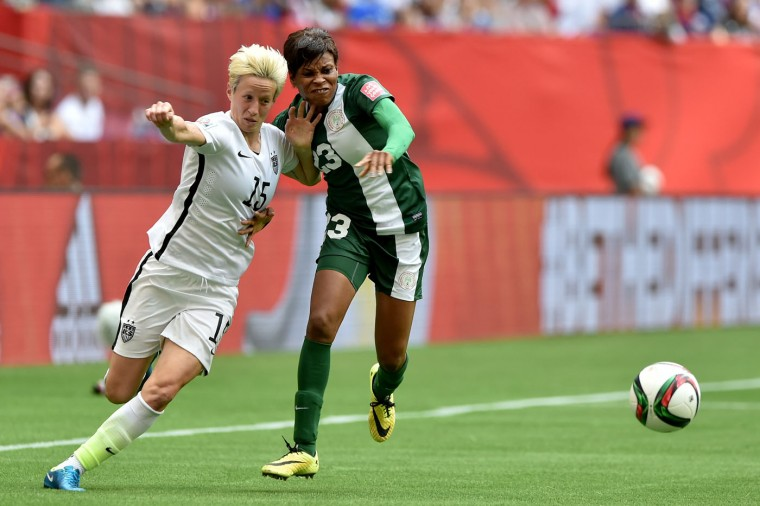 Megan Rapinoe #15 of the United States controls the ball against Ngozi Ebere #23 of Nigeria in the second half in the Group D match of the FIFA Women's World Cup Canada 2015 at BC Place Stadium on June 16, 2015 in Vancouver, Canada. (Rich Lam/Getty Images)