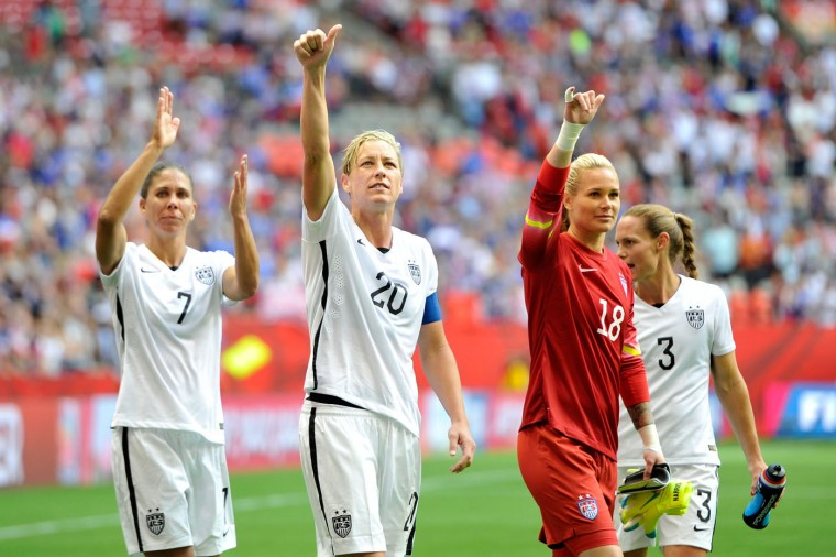 Shannon Boxx #7, Abby Wambach #20, Ashlyn Harris #18, and Christie Rampone #3 of the United States celebrate with teammates after the 1-0 victory against Nigeria in the Group D match of the FIFA Women's World Cup Canada 2015 at BC Place Stadium on June 16, 2015 in Vancouver, Canada. (Rich Lam/Getty Images)