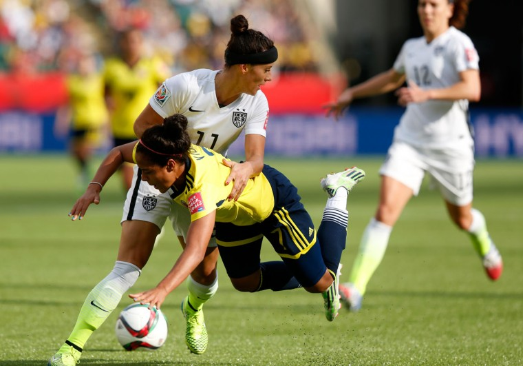 Alex Krieger #11 of the United States takes down Ingrid Vidal #7 of Colombia in the first half in the FIFA Women's World Cup 2015 Round of 16 match at Commonwealth Stadium on June 22, 2015 in Edmonton, Canada. (Todd Korol/Getty Images)