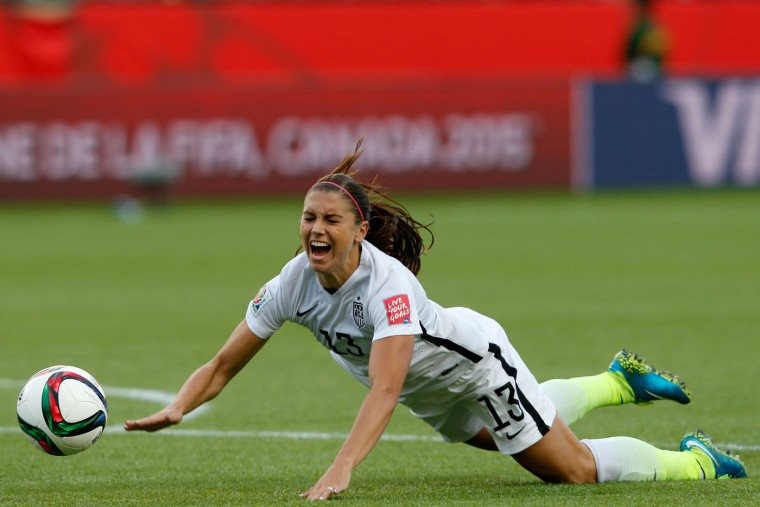 Alex Morgan #13 of the United States is tripped by goalkeeper Catalina Perez #22 of Colombia leading to a red card for Perez in the second half in the FIFA Women's World Cup 2015 Round of 16 match at Commonwealth Stadium on June 22, 2015 in Edmonton, Canada. (Todd Korol/Getty Images)