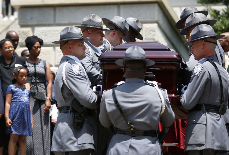 COLUMBIA, SC - JUNE 24: As lawmakers, family and friends look on, the South Carolina Highway Patrol Honor Guard carry the coffin of church pastor and South Carolina State Sen. Clementa Pinckney to lie in repose at the Statehouse Rotunda on June 24, 2015 in Columbia, South Carolina. Pinckney was one of nine people killed during a Bible study inside Emanuel AME church in Charleston. U.S. President Barack Obama and Vice President Joe Biden are expected to attend the funeral which is set for Friday June 26 at the TD Arena. (Photo by Joe Raedle/Getty Images)