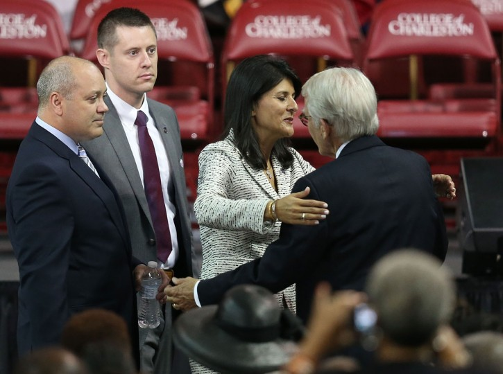 South Carolina Governor Nikki Haley hugs Charleston Mayor Joseph Riley as they arrive for the funeral at the College Charleston TD Arena where President Barack Obama is scheduled to deliver the eulogy for South Carolina State Sen. Clementa Pinckney who was killed during the mass shooting at the Emanuel African Methodist Episcopal Church along with eight others on June 26, 2015 in Charleston, South Carolina. Suspected shooter Dylann Roof, 21 years old, is accused of killing nine people on June 17th during a prayer meeting in the church, which is one of the nation's oldest black churches in Charleston. (Photo by Joe Raedle/Getty Images)